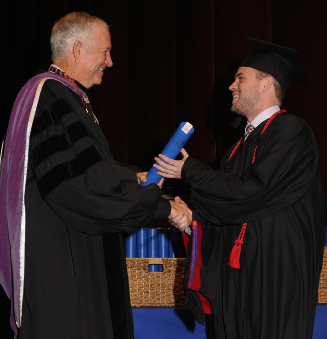 Receiving my diploma from HBU's Dr. Robert Sloan